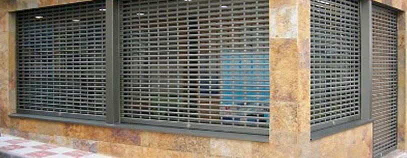 https://www.pointfort-fichet.com/wp-content/uploads/2018/06/Puerta-Enrollable-Troquelada-813x316.jpg